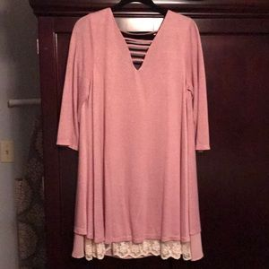 Ladies pink dress with lace detail at hemline